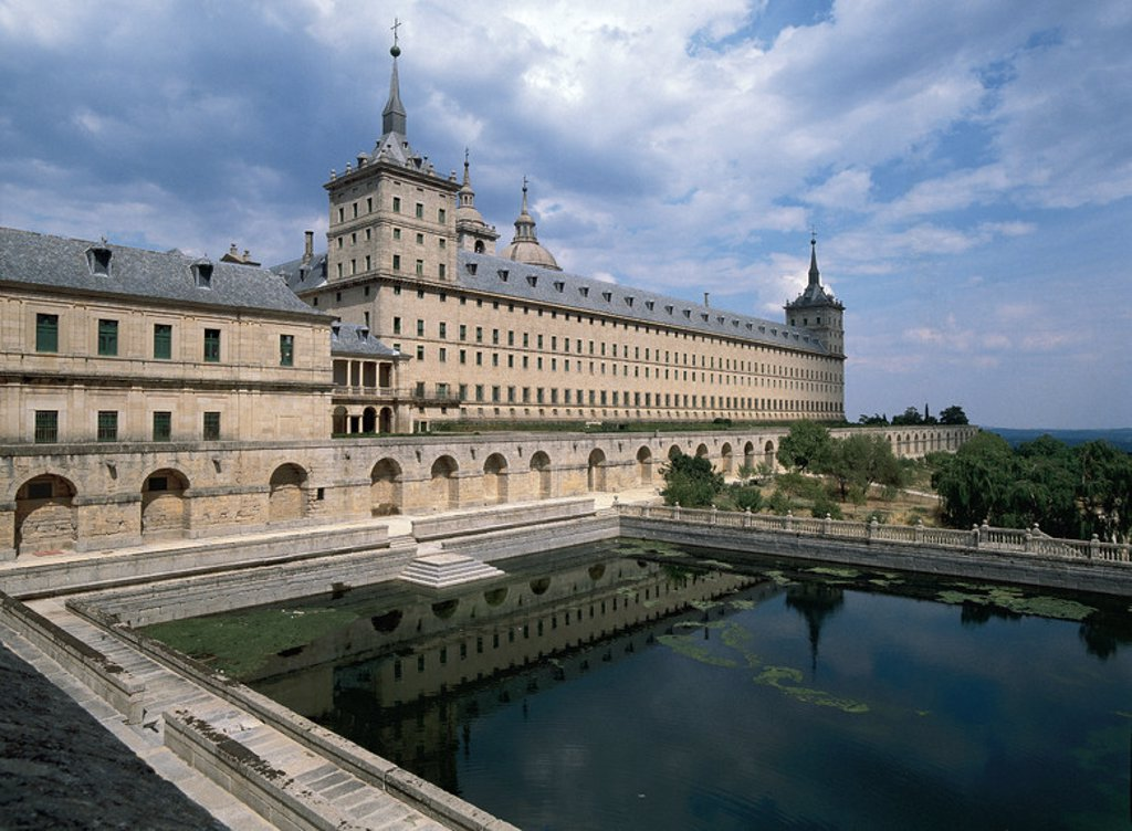 Royal Seat of San Lorenzo de El Escorial. Erected at the behest of Philip II (1557). Juan de Herrera (1530-1597) directed the work to the death of Juan Bautista de Toledo in 1567. San Lorenzo de El Escorial. Madrid. Spain. : Stock Photo