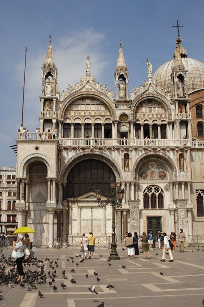 ITALY. VENICE. Saint Mark Cathedral. Romanesque-Byzantine style. It was founded in the XI cent by the Doge Domenico Conatirini  The front features two overlapping bodies of five arches each with florid Gothic auction. Saint Mark Square. : Stock Photo
