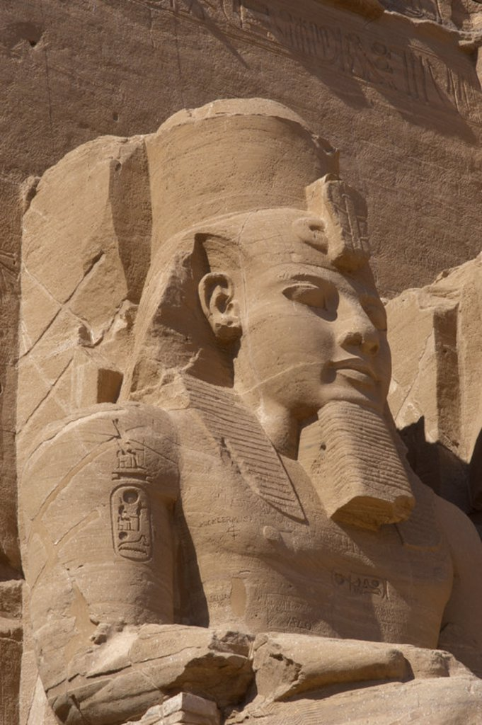 Egyptian art. Great Temple of Ramses II. Colossal statues depicting the pharaoh Ramses II (1290-1224 BC) seated with the nemes head and surmounted by the double crown. 19th Dynasty. New Kingdom.  Abu Simbel. Egypt. : Stock Photo