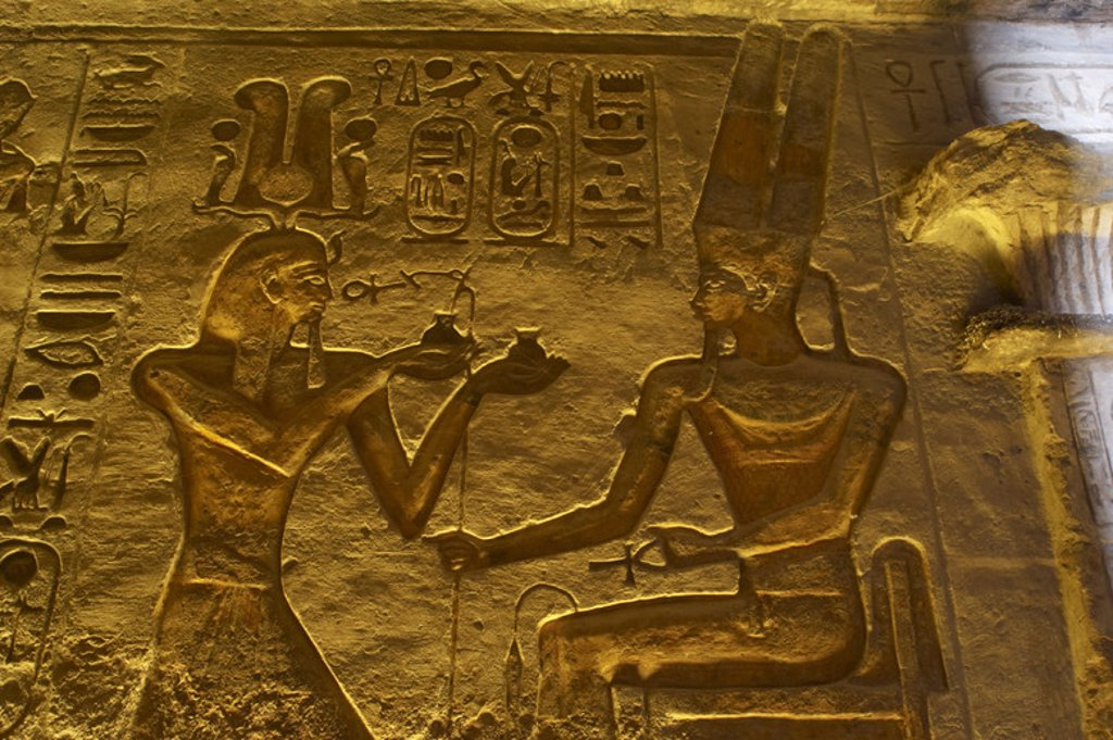 Egyptian art. Small Temple or Temple of Hathor. 19th dynasty. New Empire. Relief depicting the pharaoh Ramses II offering to god Amun. Abu Simbel. Egypt. : Stock Photo
