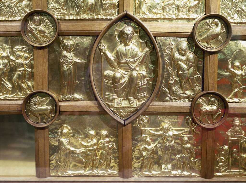 Stock Photo: 4409-38425 Aachen Cathedral. Palatine Chapel. Frontal of Main Altar, know as Pala d'Oro. 1000. Golden panels depicting Christ enthroned inside a mandorla (centre) flanqued by Virgin Mary and St. Michael. Small medaillons depicts symbols of Four Evangelists and the other scenes represents the Passion of Christ. Detail. Germany.