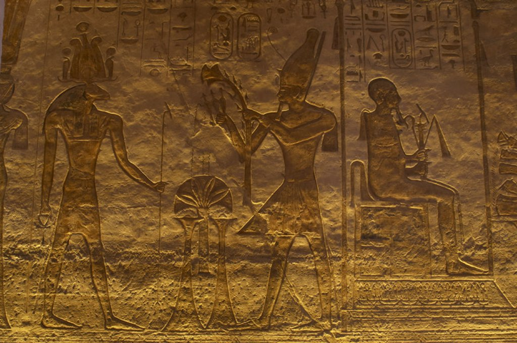 Stock Photo: 4409-38500 Egyptian art. Small Temple or Temple of Hathor. 19th dynasty. New Empire. Relief depicting the pharaoh Ramses II offering to the god. Abu Simbel. Egypt.