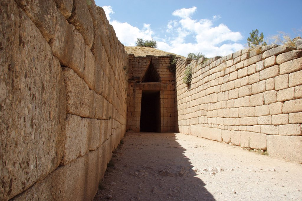 "Mycenaean civilization. Mycenae.  Treasury of Atreus or Tomb of Agamemnonis ""Tholos"". Entrance to the tomb grave. Built around 1250 BC. Peloponese. Greece. Europe. : Stock Photo"