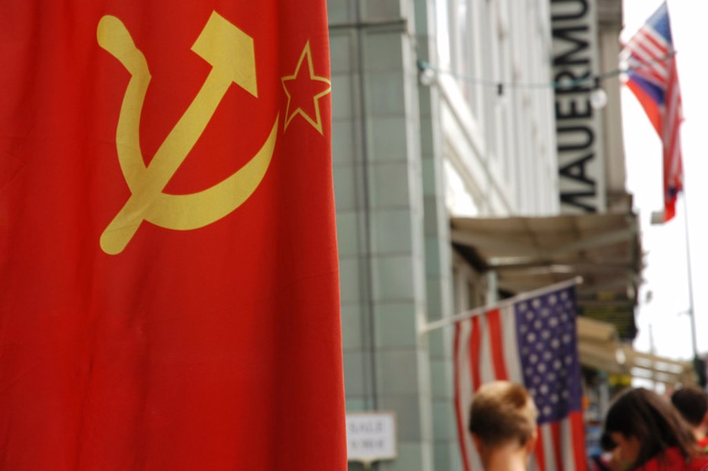 Stock Photo: 4409-38737 Flag of the former USSR in Checkpoint Charlie, the most famous of the crossing points of the Berlin Wall between the two parts of the city. Berlin. Germany.