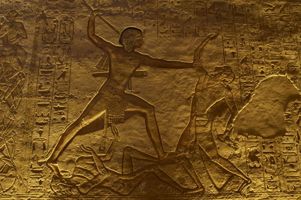 Stock Photo: 4409-39689 Egyptian art. Great Temple of Ramses II.  Military campaign. The pharaoh Ramses II fighting with an enemy. 19th Dynasty. New Kingdom. Abu Simbel. Egypt.