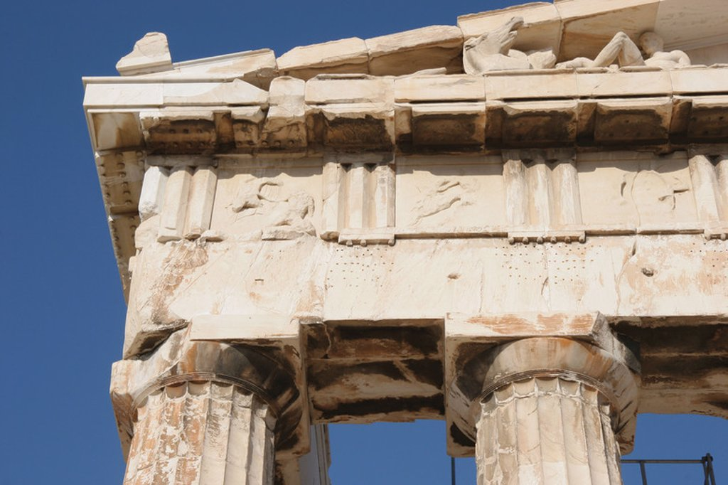 Stock Photo: 4409-40082 Greek Art. Parthenon. Was built between 447-438 BC. in Doric style under leadership of Pericles. The building was designed by the architects Ictinos and Callicrates.  Detail of entablature ( frieze with triglyphs and metopes, architrave, capital with abacus, echinus and necking ). Acropolis. Athens. Attica. Central Greek. Europe.