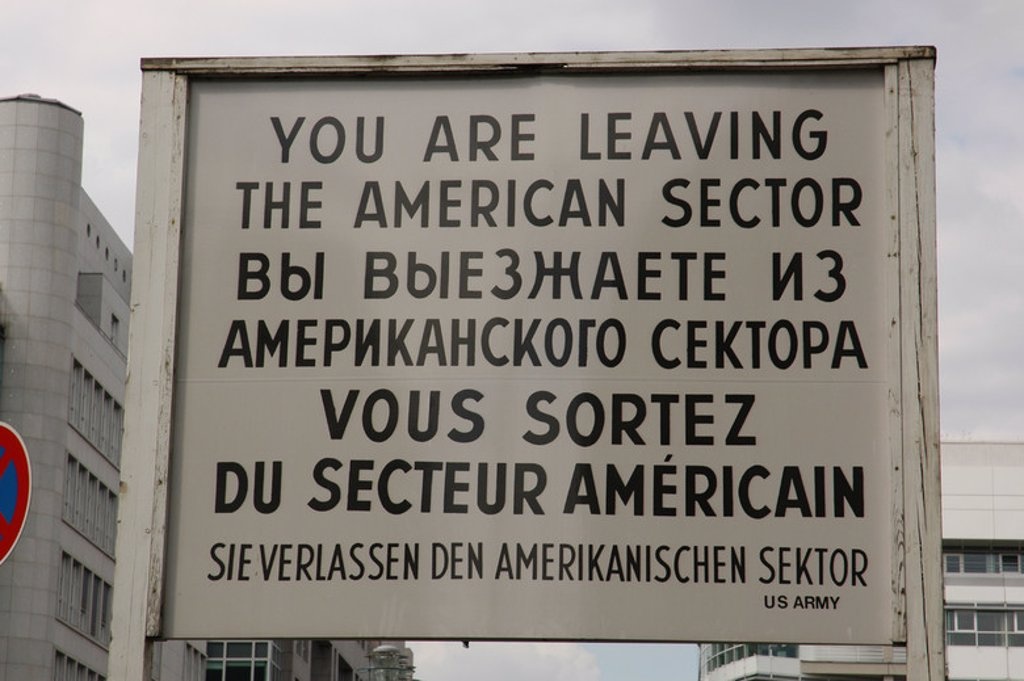 Stock Photo: 4409-40138 Checkpoint Charlie. The most famous of the crossing points of the Berlin Wall between the two parts of the city. Placard. Berlin. Germany.