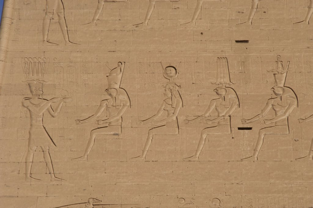 Stock Photo: 4409-40270 Temple of Horus. Pharaoh before gods. Main entrance. First pylon. Detail. Edfu. Egypt.