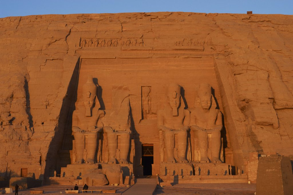 Stock Photo: 4409-40384 Egyptian art. Great Temple of Ramses II. Four colossal statues depicting the pharaoh Ramses II (1290-1224 BC) seated with the nemes head and surmounted by the double crown. 19th Dynasty. New Kingdom.  Abu Simbel. Egypt.