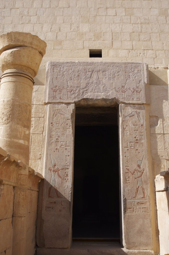Temple of Hatshepsut. Door with polychrome reliefs representing the pharaoh Hatshepsut with masculine attributes. 18th Dynasty. New Kingdom. Deir el-Bahri. Egypt. : Stock Photo