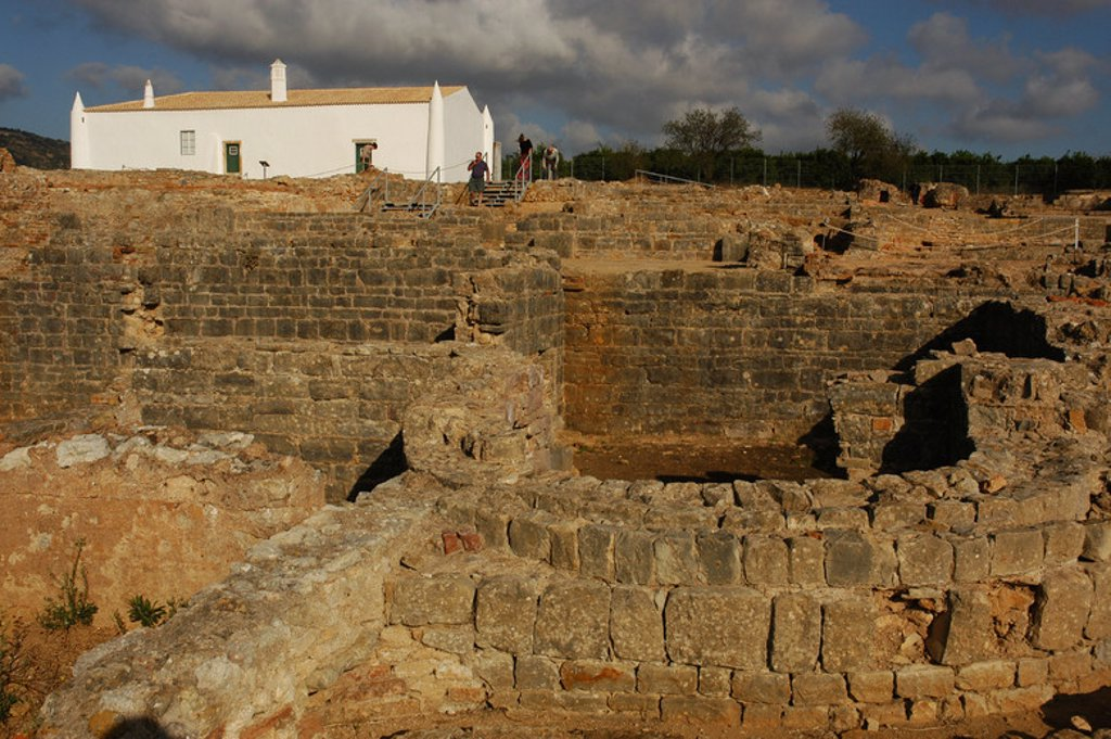Ruins of Milreu. Roman Villa (1st - 4th century A.D.). In the foreground, the Baths. Behind, a sixteenth century house. Estoi, near Faro. Algarve. Portugal. : Stock Photo