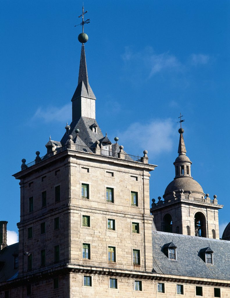 Monastery of El Escorial erected at the behest of Philip II (1557). Juan de Herrera (1530-1597) directed the work to the death of Juan Bautista de Toledo in 1567. Tower-spire. San Lorenzo de El Escorial. Madrid. Spain. : Stock Photo