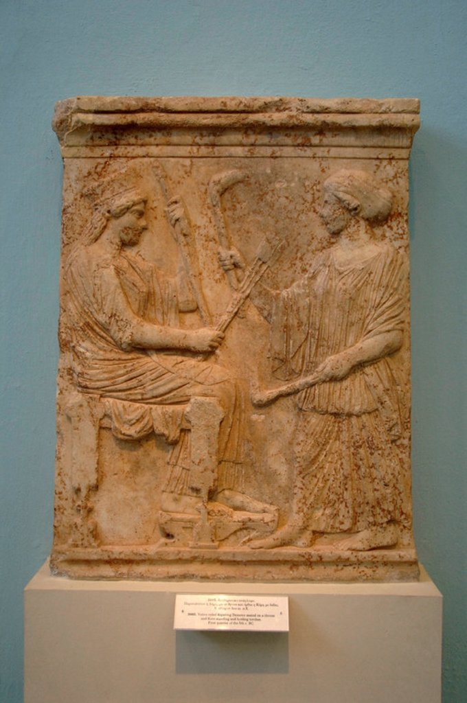Stock Photo: 4409-41381 GREEK ART. GREECE. Votive relief representing Demeter sitting on a throne and kore standing holding torches. Dated in the first quarter of s.V b.C. Museum of Eleusis. Athens. Greece.