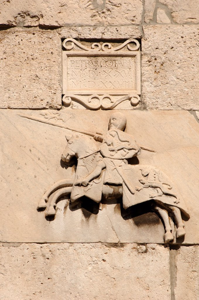 Stock Photo: 4409-42174 Knight with shield and spear. Detail of the facade of the City of Pula. Croatia.