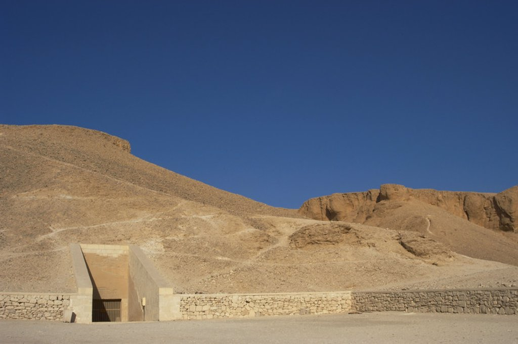 Stock Photo: 4409-42461 Valley of the Kings. On the walls are carved rock tombs of New Kingdom pharaohs. Entrance to the tomb of the Pharaoh Ramses IV. Egypt.