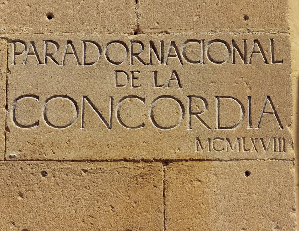 Stock Photo: 4409-42895 Inscription carved in stone of the National Parador of the Concordia. Alcaniz. Aragon. Spain.