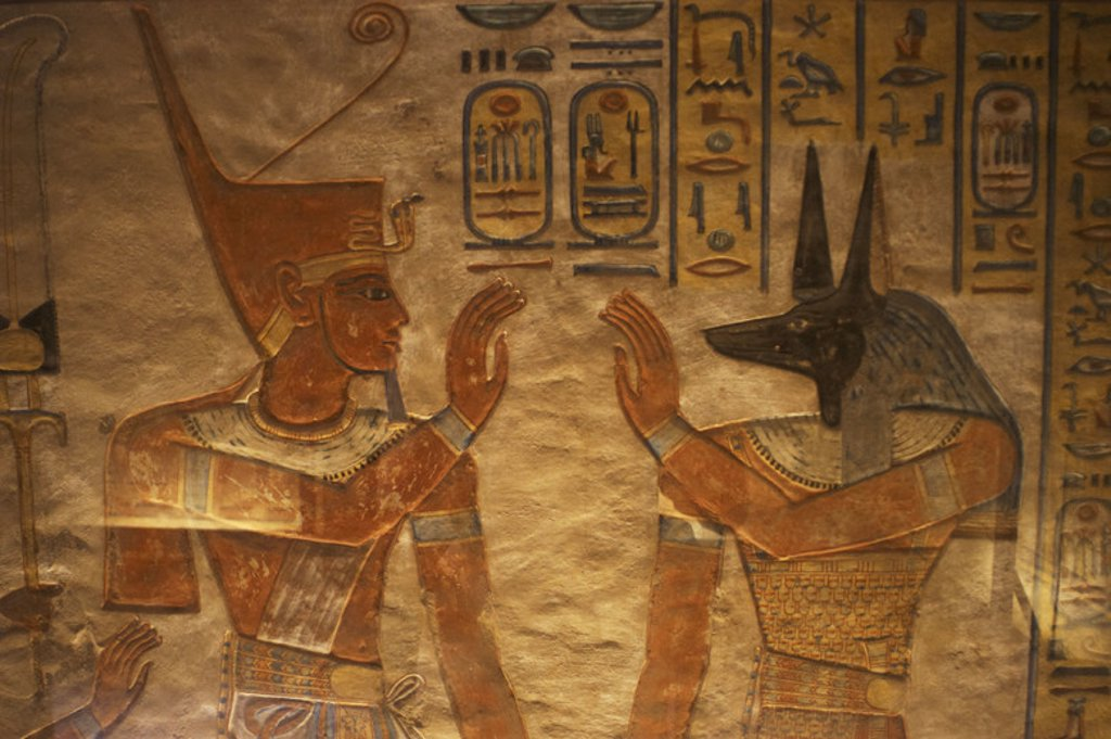 Stock Photo: 4409-45200 Tomb of Amen Khopshef, son of Ramses III. Polychrome reliefs decorating the walls of the burial chamber. God Anubis on the right. Twentieth dynasty. New Kingdom. Valley of the Queens. Egypt.