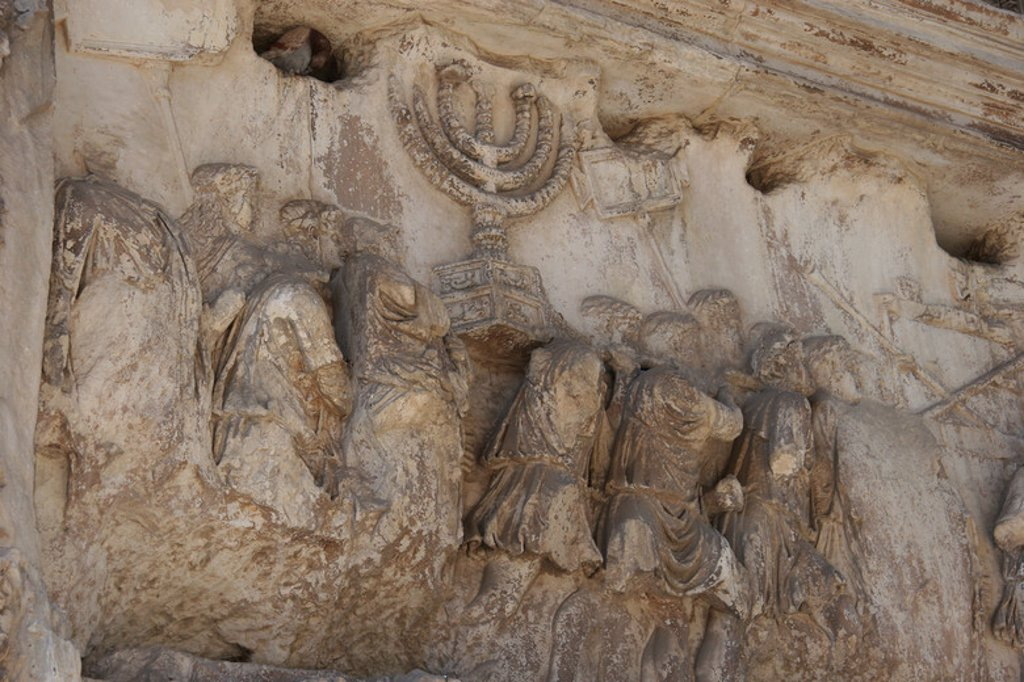 Stock Photo: 4409-45234 Roman Art. Arch of Titus. Triumphal arch, with a single arched, located on the Via Sacra. South-East of the Forum. It was constructed by the emperor Domitian commemorating the capture and sack of Jerusalem in 70 (Jewish war). Detail from the arch of Titus showing spoil from the sack of Jerusalem. Rome. Italy. Europe.