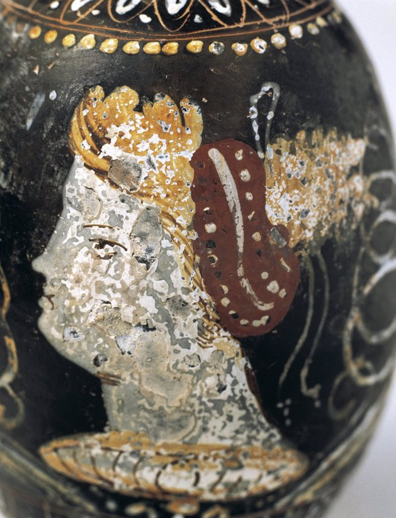 Stock Photo: 4409-45395 Art Greek. Magna Graecia. Greek vase painting. Red figure pottery. Lekythus. Used for storing oil. Decorated with a female face. Egnatia, Italy. Museum of Perfume. Barcelona.  Spain.