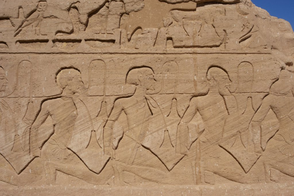 Egyptian art. Relief depicting a group of prisoners with Asian features (symbolizing the enemies of Egypt border). Temple of Ramses II. New Kingdom. Abu Simbel. Egypt. : Stock Photo
