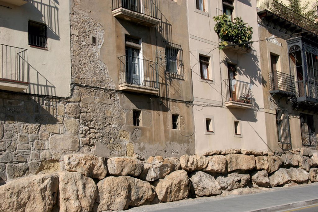 Stock Photo: 4409-46079 Spain. Catalonia. Tarragona. Houses in the old town. At the botton, the remains of the roman cyclopean wall.