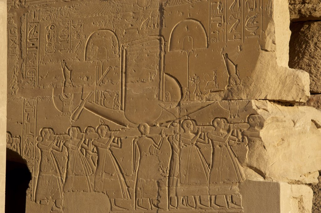 Stock Photo: 4409-46180 Ramesseum. Relief depicting the sacred solar boat carried by priests. 13th century B.C. Nineteenth Dynasty. New Kingdom. Necropolis of Thebes. Valley of the Kings. Egypt.