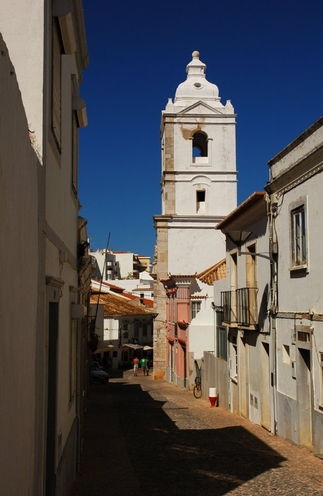 Portugal. Lagos. View of a street with the bell tower of the church of San Antonio, at background. Algarve. : Stock Photo