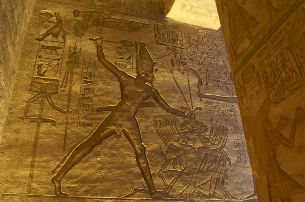 Stock Photo: 4409-46539 Egyptian art. Great Temple of Ramses II. 19th Dynasty. New Kingdom. Military campaign. Pharaoh Ramses II with prisoners of war. Abu Simbel. Egypt.