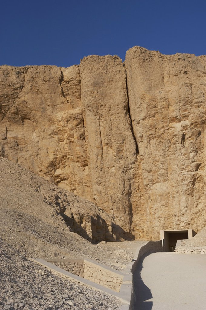 Stock Photo: 4409-46676 Valley of the Kings. On the walls are carved rock tombs of New Kingdom pharaohs. Entrance to the tomb of the Pharaoh Amenophis II. Egypt.