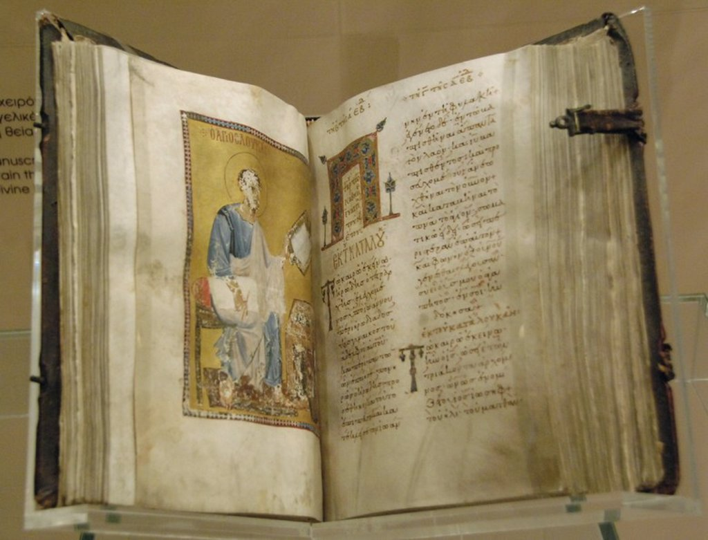BYZANTINE ART. GREECE. Lectionary illuminated and manuscript containing the Gospel passages read during the Divine Liturgy. Open book. Byzantine Museum. Athens. : Stock Photo