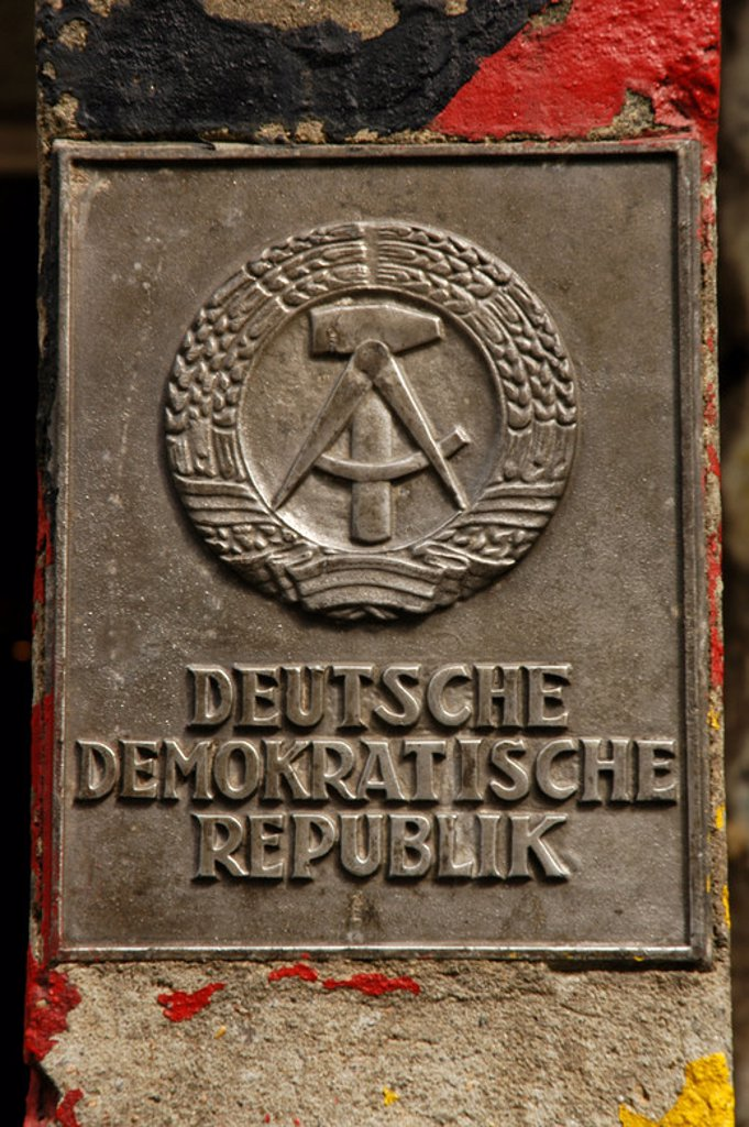 Stock Photo: 4409-47529 Germany. Berlin. The National Emblem of the German Democratic Republic. A hammer and a compass, surrounded by a ring of rye.