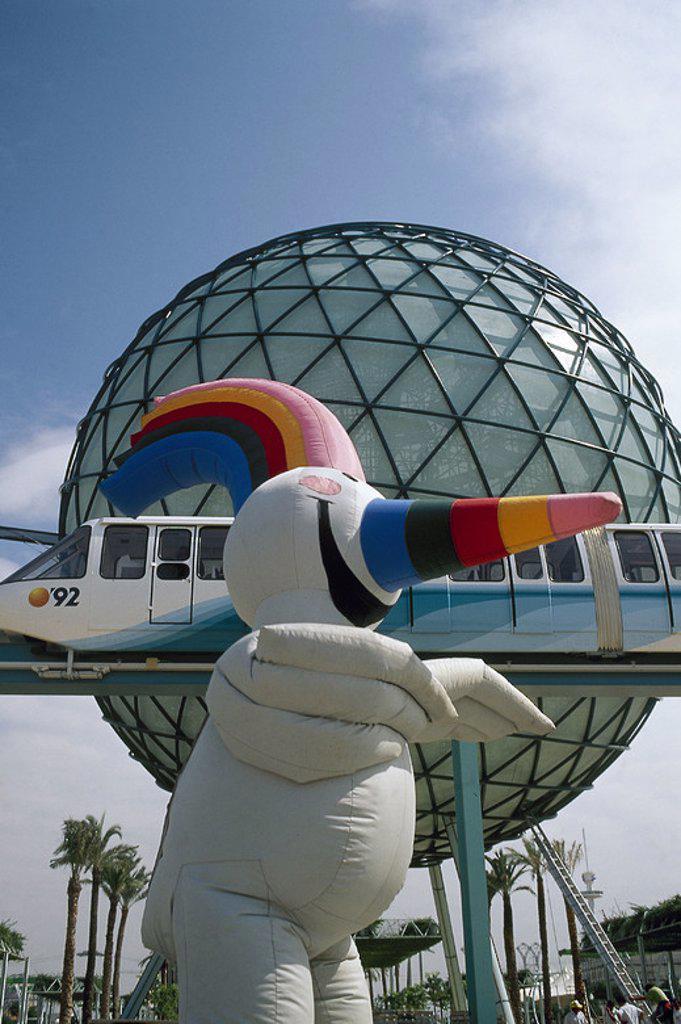 """Stock Photo: 4409-47617 EXPOSICION UNIVERSAL DE SEVILLA'92. Vista de la mascota de la Exposición, llamada """"CURRO"""". En segundo término, la ESFERA BIOCLIMATICA. SEVILLA. Andalucía. España."""