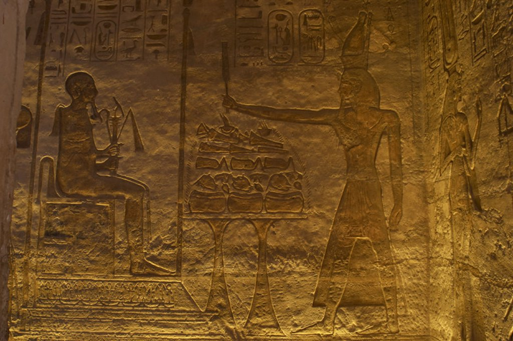 Stock Photo: 4409-47965 Egyptian art. Small Temple or Temple of Hathor. 19th dynasty. New Empire. Relief depicting the pharaoh Ramses II offering to god Ptah. Abu Simbel. Egypt.