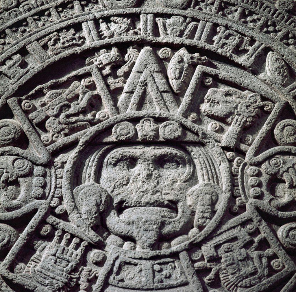 Stock Photo: 4409-48256 ARTE PRECOLOMBINO. AZTECA. MEXICO. CALENDARIO AZTECA o PIEDRA DEL SOL. Labrado en un monolito de basalto de 3.60 m de diámetro. Perteneciente al PERIODO POSTCLASICO TARDIO (1325-1521 d.C.). Detalle de la FIGURA CENTRAL QUE REPRESENTA A TONATIUH (EL SOL). Sala Mexica. Museo Nacional de Antropología. MEXICO D.F.