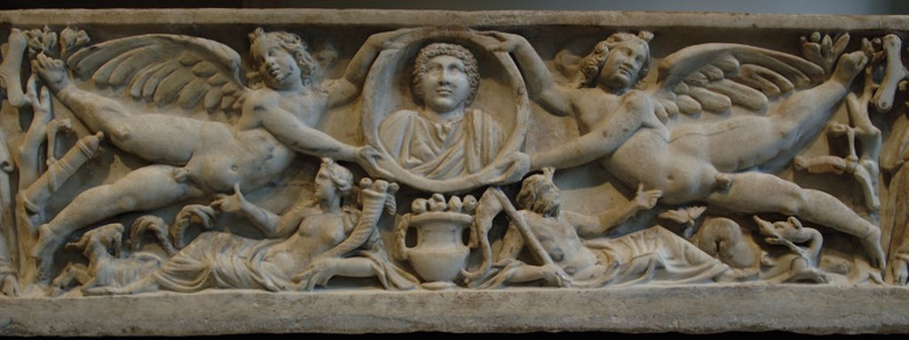 Roman Art. Marble sarcophagus with flying erotes holding a clipeus portrait. At the bottom, the Earth and the Ocean. Dated between 190-200. Severan period. Metropolitan Museum of Art. New York. United States. : Stock Photo