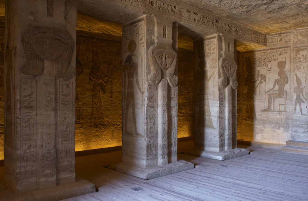 Egyptian art. Small Temple or Temple of Hathor. Inside view. Pillar carved with the bust of the goddess Hathor. 19th Dynasty. New Kingdom. Abu Simbel. Egypt. : Stock Photo