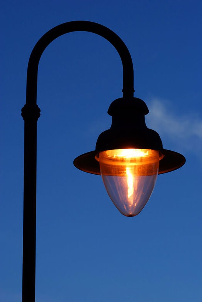 Lighted lamp. : Stock Photo