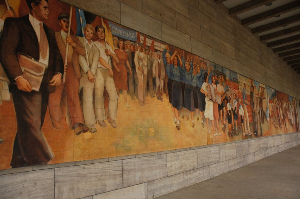 Germany. Berlin. Facade of the Ministry of Aviation, the only Nazi Ministry still standing. Detail of the frescoes with themes of exaltation of communism. : Stock Photo