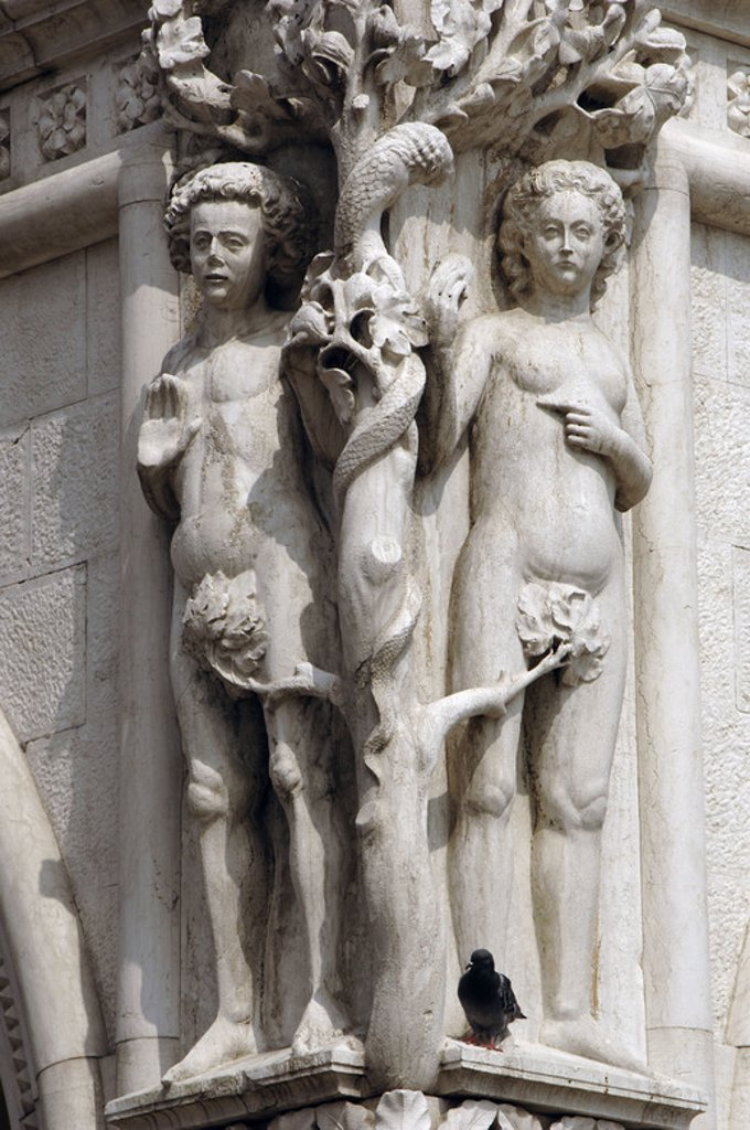 Italy. Venice. Doge's Palace. Sculpture depicting Adam and Eve tempted by the serpent. Original Sin. : Stock Photo