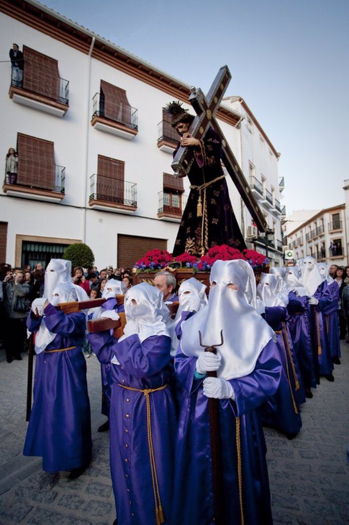 Stock Photo: 4409-52838 SEMANA SANTA. PROCESION DEL VIERNES SANTO. NAZARENOS PORTANDO UN PASO. Montefrío. Provincia de Granada. Andalucía. España.
