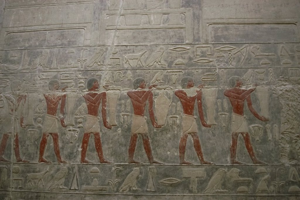 Stock Photo: 4409-55219 Mastaba of Kagemni (2350 BC). Chief Justice and vizier of the Pharaoh Teti. Hall of the False Door Stela. Relief depicting servants carrying offerings to the Ka of the deceased. Old Kingdom. Saqqara. Egypt.