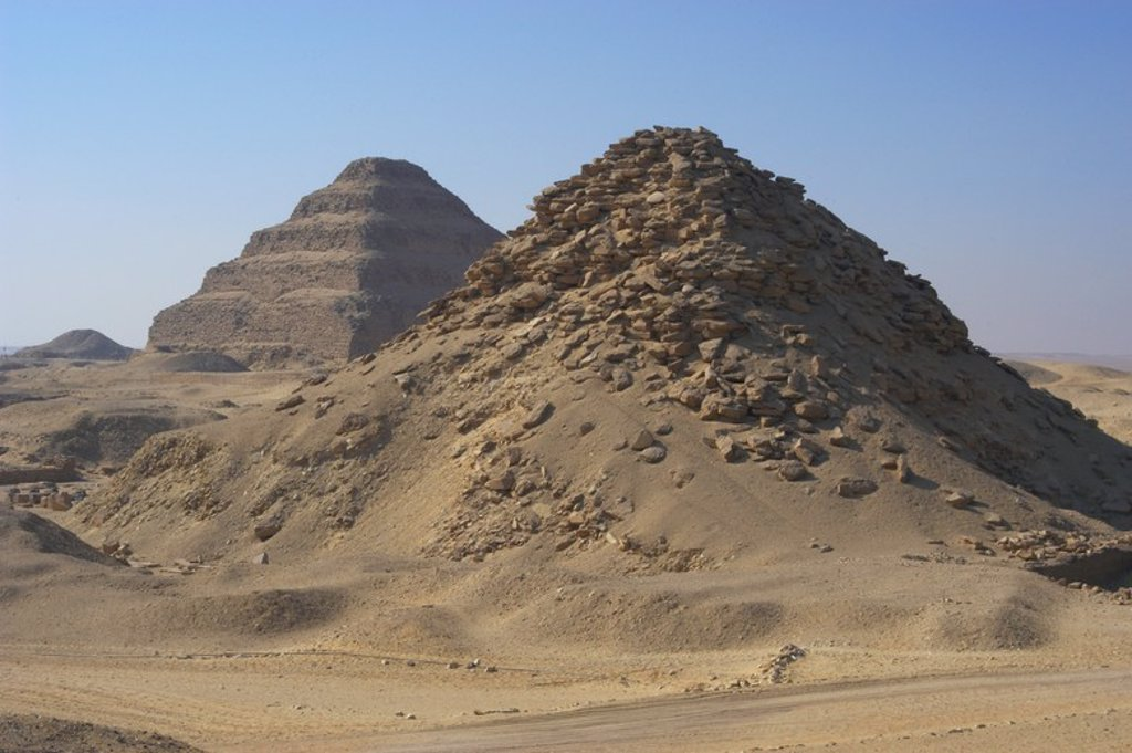 Stock Photo: 4409-55226 Pyramid of Userkaf. At background, Djoser Pyramid. Old kingdom. Saqqara. Egypt.