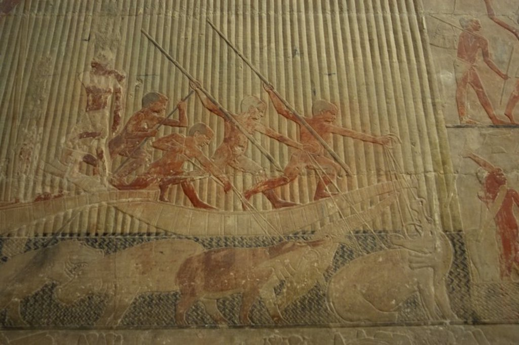 Egypt. Saqqara. Mastaba of Ti. 5th Dynasty. Old Kingdom. Relief depicting hunting scene. Hunters nailing his lances into the hippos and crocodiles. : Stock Photo