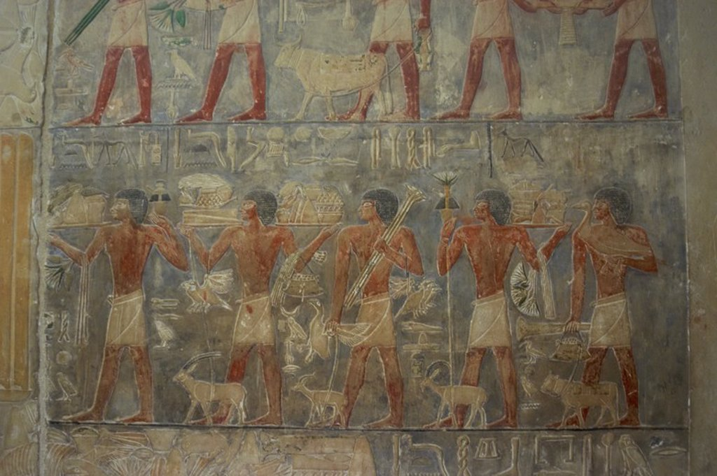 Mastaba of Ptahhotep and Akhethotep. Egyptian viziers. Father and son. Relief depicting servers carrying the funerary food of Ptahhotep. West wall. Saqqara. Egypt. : Stock Photo