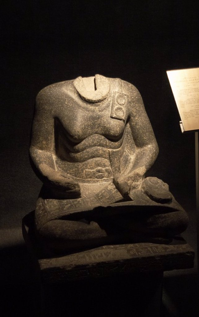 Statue of Mentuhotep. Middle Kingdom. 12th Dynasty. Vizier under Sesostris I. Headless statue, represented as a scribe, from Temple of Amun at Karnak. Egyptian Art Museum. Luxor. Egypt. : Stock Photo
