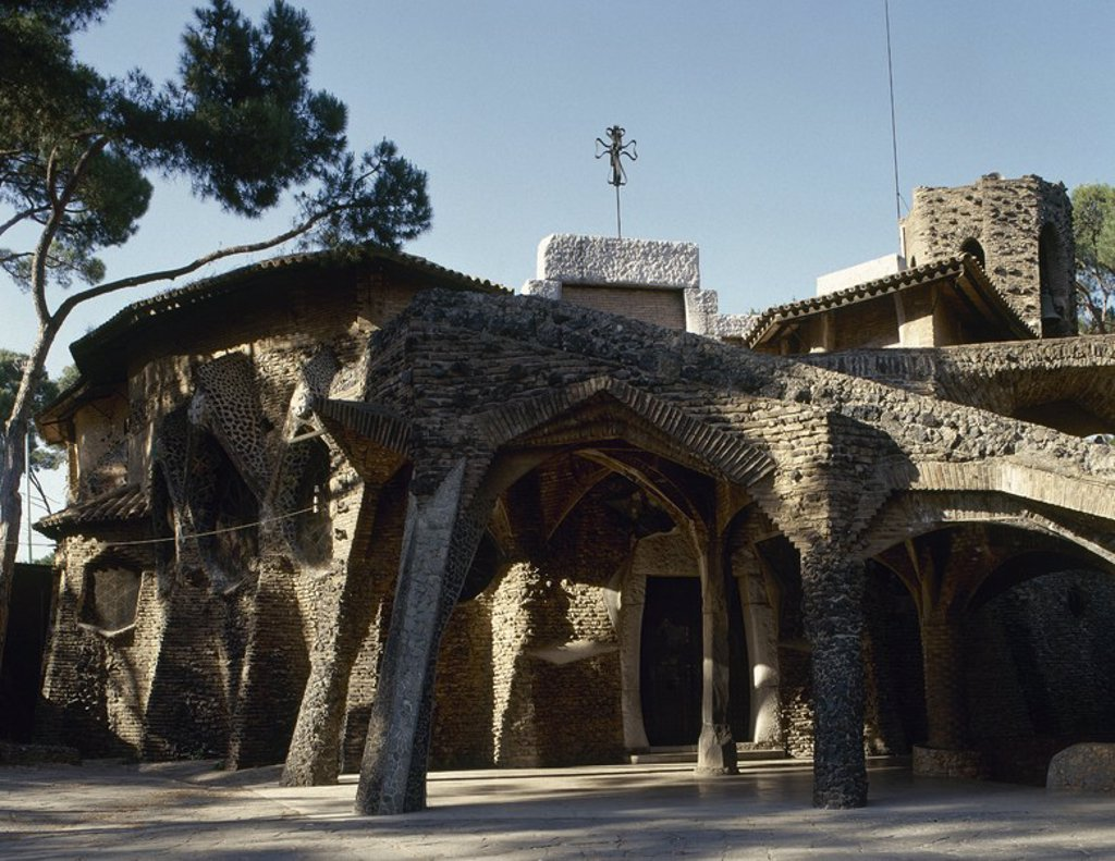 Spain. Catalonia. Santa Coloma del Cervello. The Crypt of the Church of Colonia Guell (1908-1915). Built by Antoni Gaudi (1852-1926). Outside. : Stock Photo