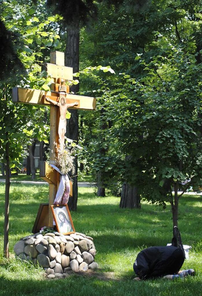 Stock Photo: 4409-56134 Orthodox Church. Woman praying. Khreschatyk Park. Kiev. Ukraine.