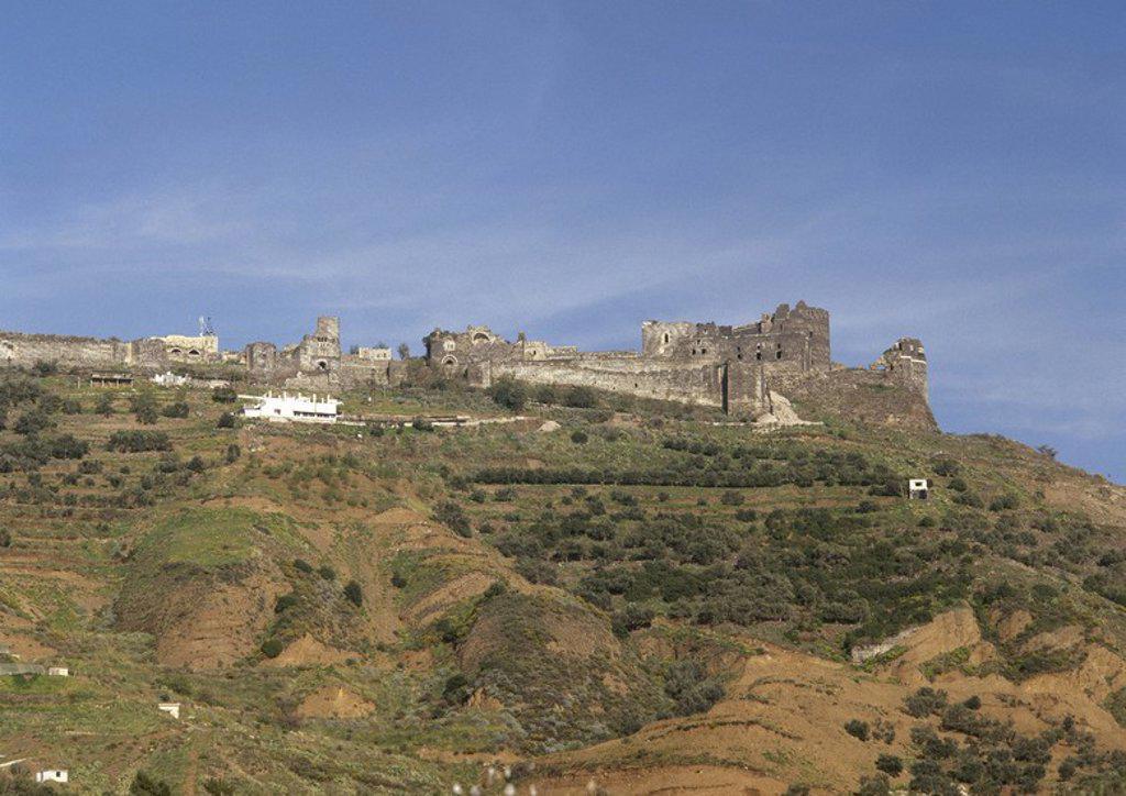 Stock Photo: 4409-56763 SIRIA. Vista general del CASTILLO DE QALAAT MARQAB, inicialmente fortificado por los árabes en 1062, y posteriormente enclave de los Cruzados a principios del siglo XII. En 1186 los Caballeros Hospitalarios decidieron afincarse en él.