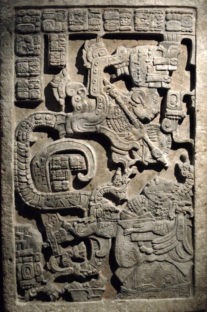 Stock Photo: 4409-60089 ARTE MAYA. PERIODO CLASICO TARDIO (600-900 d. C.). DINTEL 25 DE YAXCHILAN (h. 725 d. C.). Relieve de piedra caliza. Forma parte del grupo de tres relieves encargados por el rey ESCUDO JAGUAR II para la puerta de la ESTRUCTURA 23. Representación de K'AB'AL XOOK, ESPOSA DE ESCUDO JAGUAR, REALIZANDO UN SACRIFICIO DE SANGRE Y ASUSTADA ANTE LA APIRICION DE UN ANTEPASADO DE LAS FAUCES DE UNA SERPIENTE. Yaxchilán. Estado de Chiapas. México. Museo Británico. Londres. Inglaterra. Reino Unido.