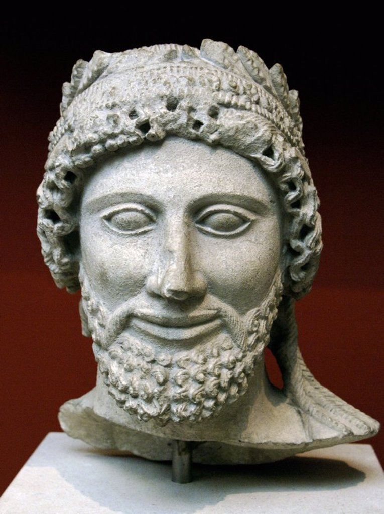 Head from a statue of a bearded man with laurel wreath. Limestone. Sculpted in Cyprus between 475-450 BC. From the Sanctuary of Apollo at Idalion. British Museum. London. England. United Kingdom. : Stock Photo